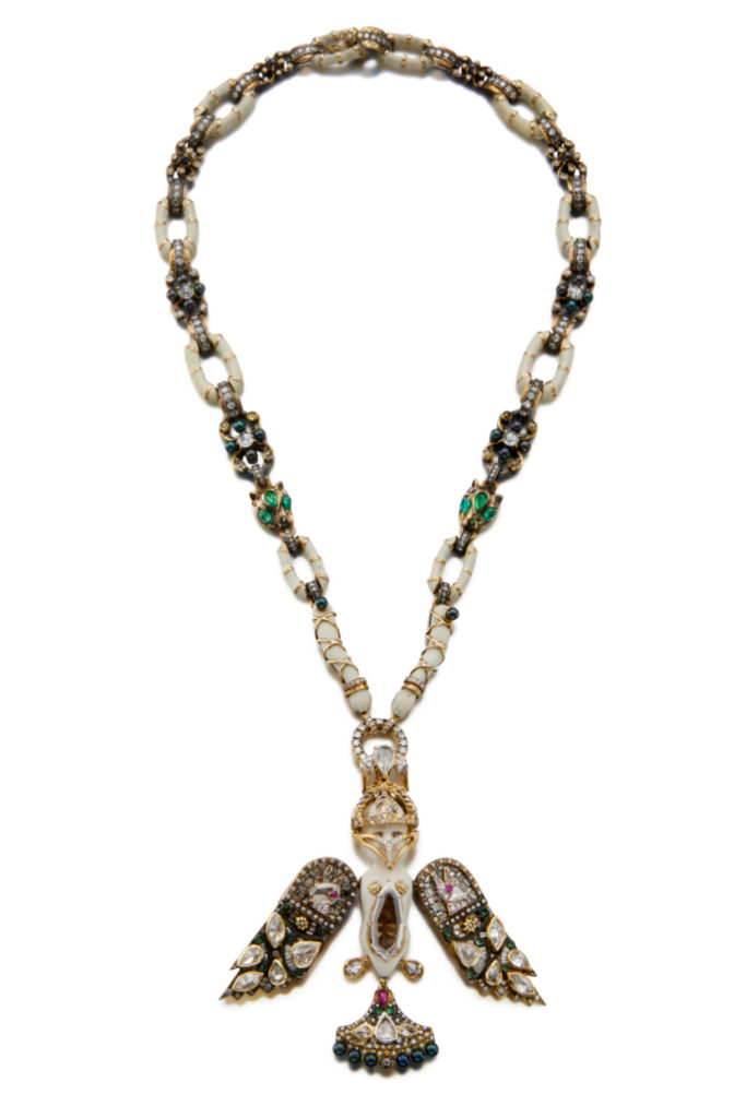 The Bisque Doll necklace by Castro. This remarkable piece converts into a shorter necklace and the pendant is detachable.