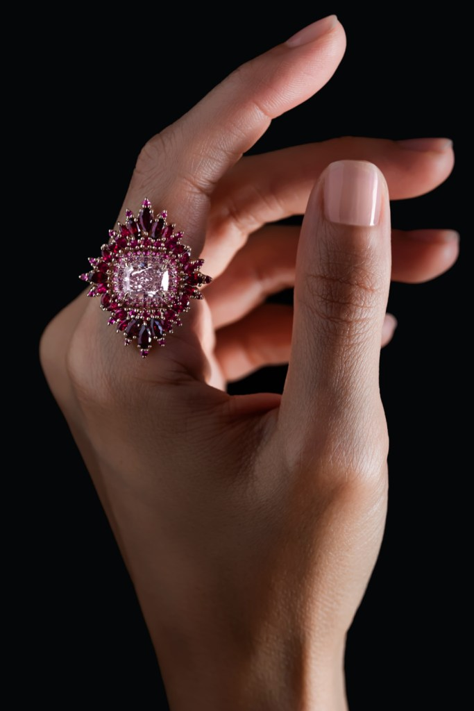 The In Bloom ring by Maggi Simpkins. A beautiful cushion-cut pink diamond surrounded b pink sapphires and rubies.