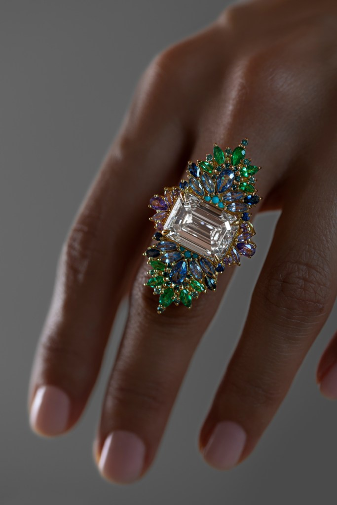 The Peacock ring by Maggi Simpkins. With a 10.13 ct emerald cut diamond, sapphires, emeralds, and blue diamonds. Beautiful!