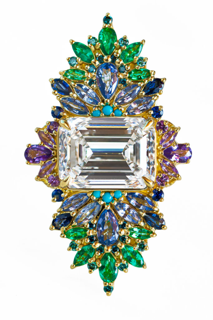 The Peacock ring by Maggi Simpkins. With a 10.13 ct emerald cut diamond, sapphires, emeralds, and blue diamonds. Exquisite!