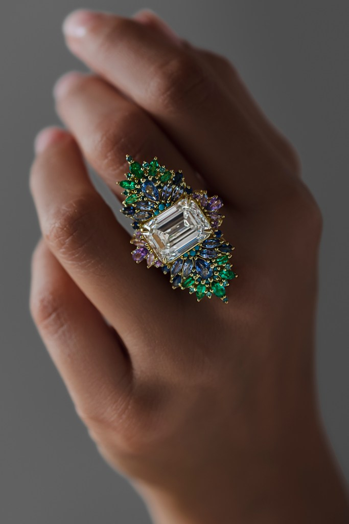 The Peacock ring by Maggi Simpkins. With a 10.13 ct emerald cut diamond, sapphires, emeralds, and blue diamonds.