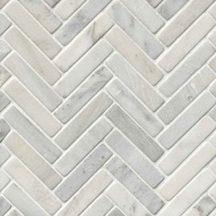 https diamontile com product west hampton carrara marble tumbled large herringbone mosaic tile