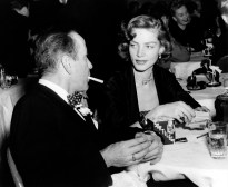 FILE - This Feb. 1950 file photo shows actor Humphrey Bogart, left, and his wife actress Lauren Bacall appear at the Stork Club in New York. Bacall, the sultry-voiced actress and Humphrey Bogart's partner off and on the screen, died Tuesday, Aug. 12, 2014 in New York. She was 89. (AP Photo, File)