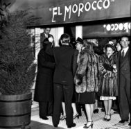 Patrons stand outside the El Morocco, E. 52d St., after being told that the club is filled to capacity.