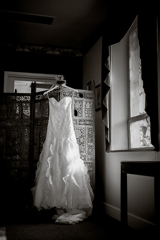 black and white wedding dress in window light