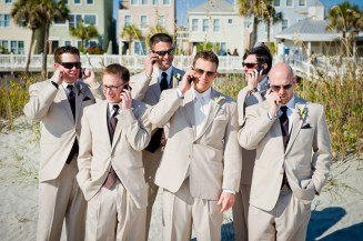 charleston wedding groomsmen and groom on cell phones
