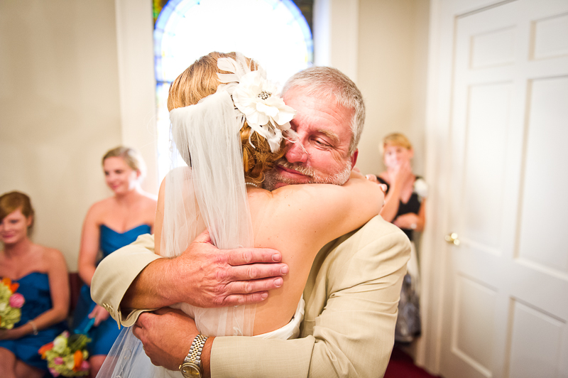 father of the bride hugging bride