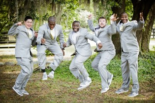 groom and groomsmen jumping at pepper plantation