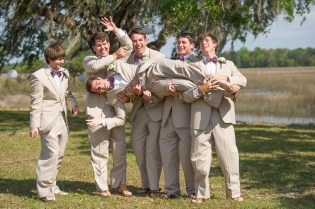 grooms men lifting groom in charleston sc