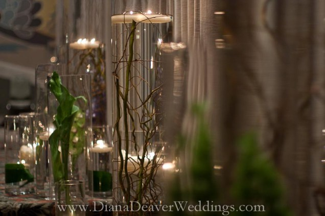 glass, flowers and candles wedding decorations captured by wedding photographer Diana Deaver in Charleston SC-2
