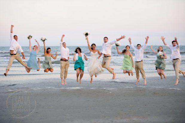 wedding party jumping on the beach kiawah
