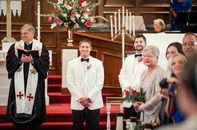 groom's reaction as bride walk down the isle