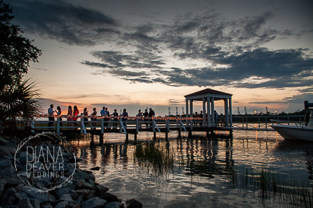 wedding dock at the creek club at ion at dusk with wedding guests