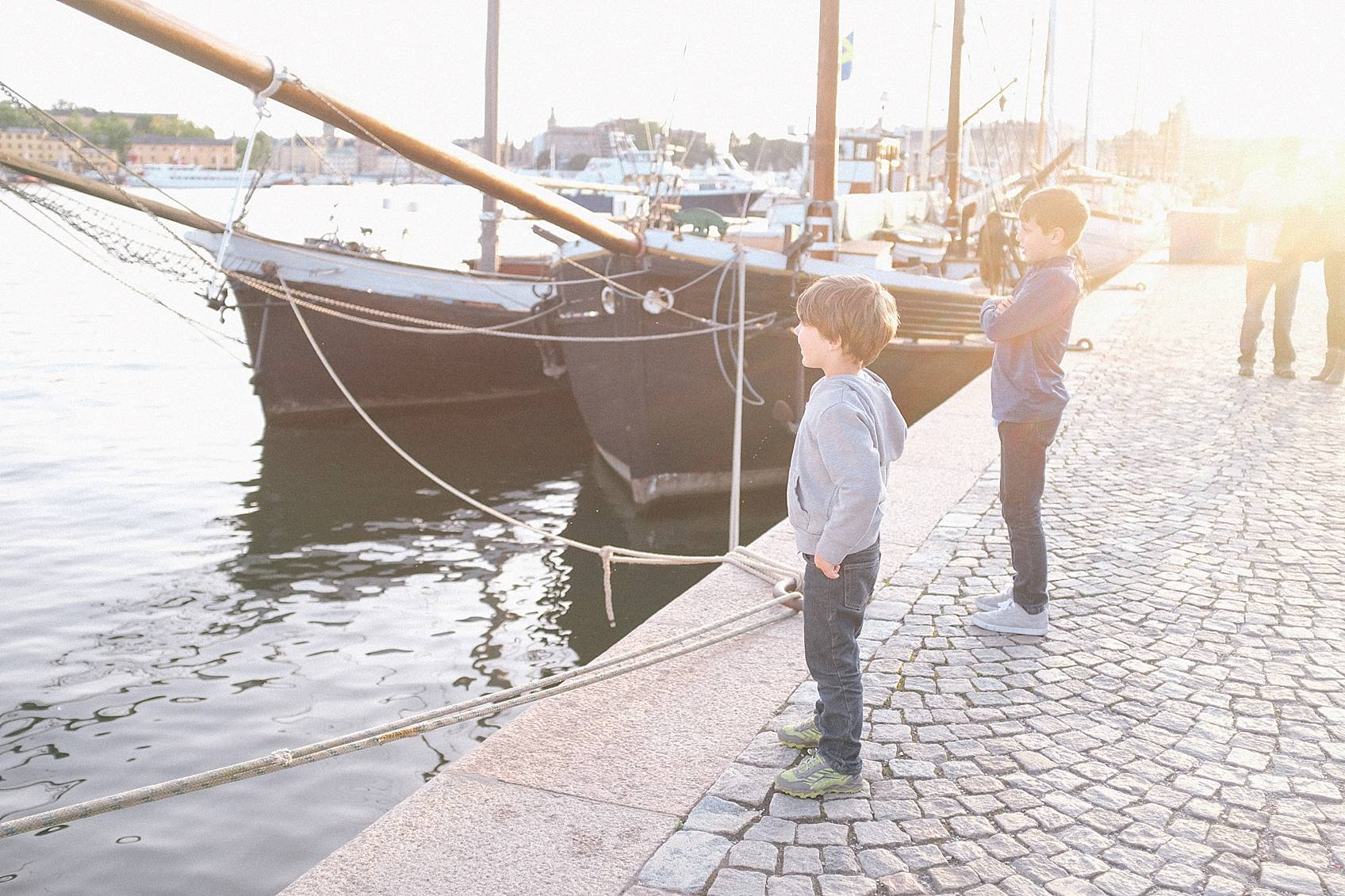 Photo tour of Stockholm: by the ocean ships boys watching a small boat go by