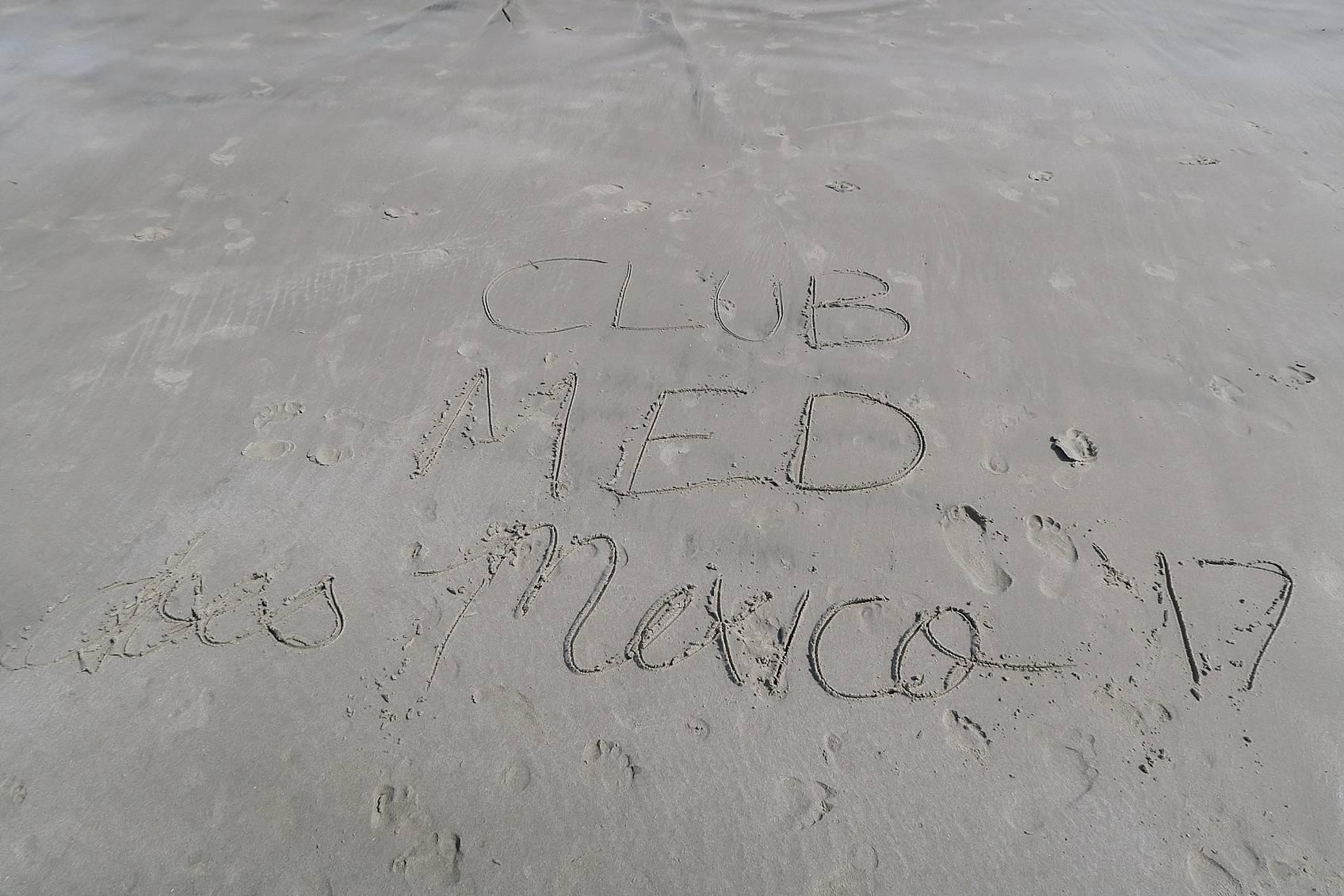 Club MED written in sand