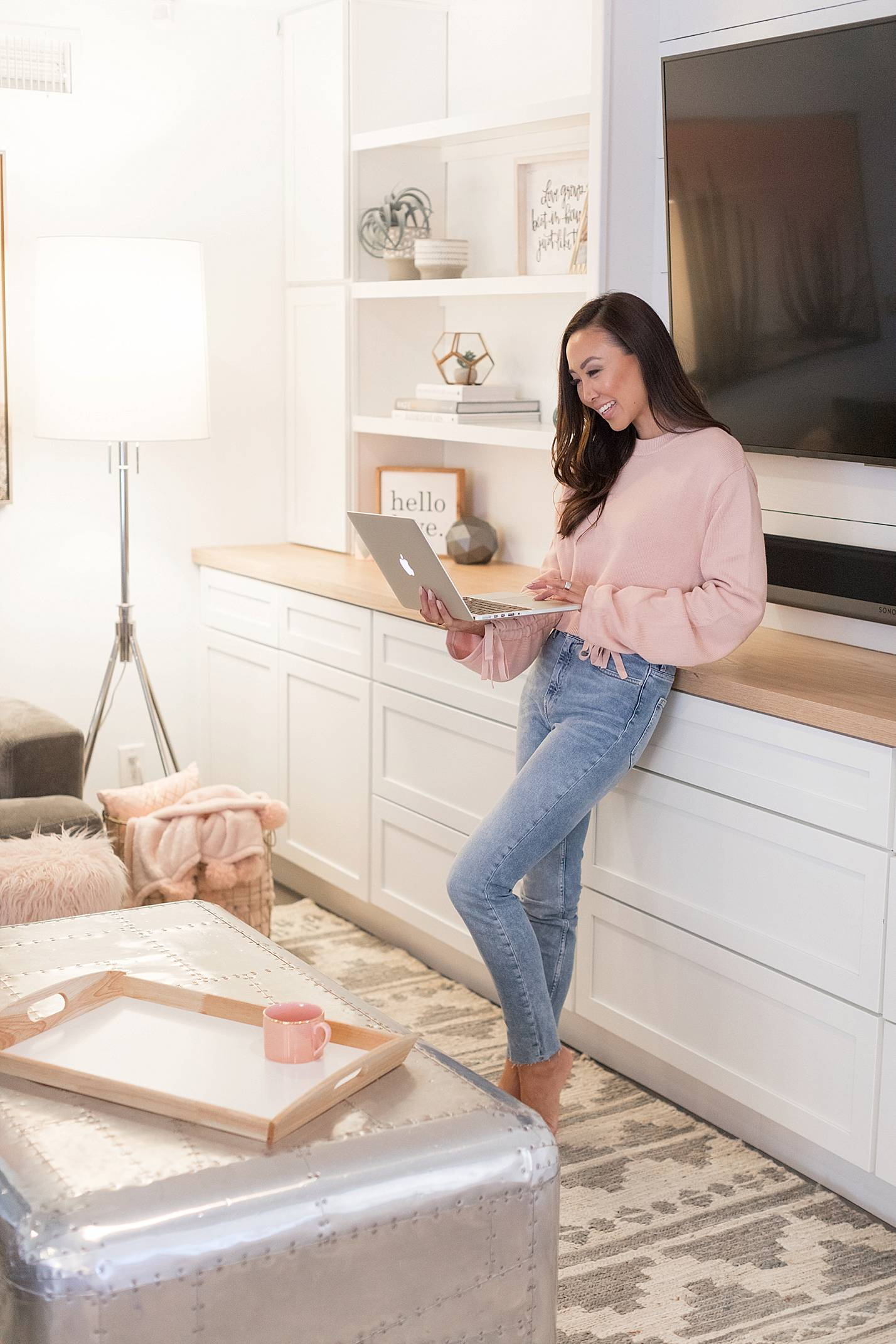 lifestyle tech blogger diana Elizabeth on laptop Wireless router by Norton Core security fits well into home decor