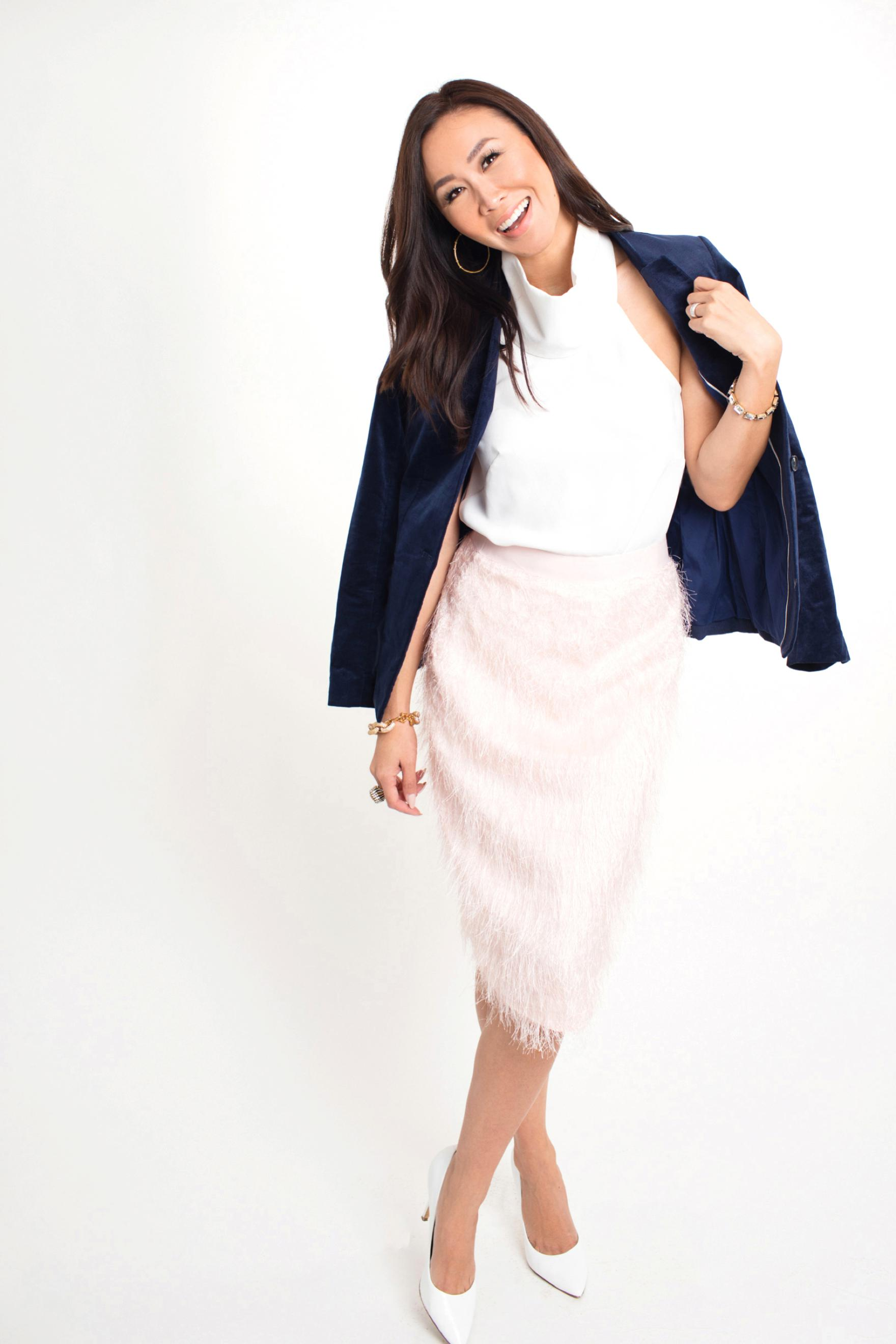 banana republic pink eyelash fringe skirt blue velvet blazer holiday outfit looks on Diana Elizabeth