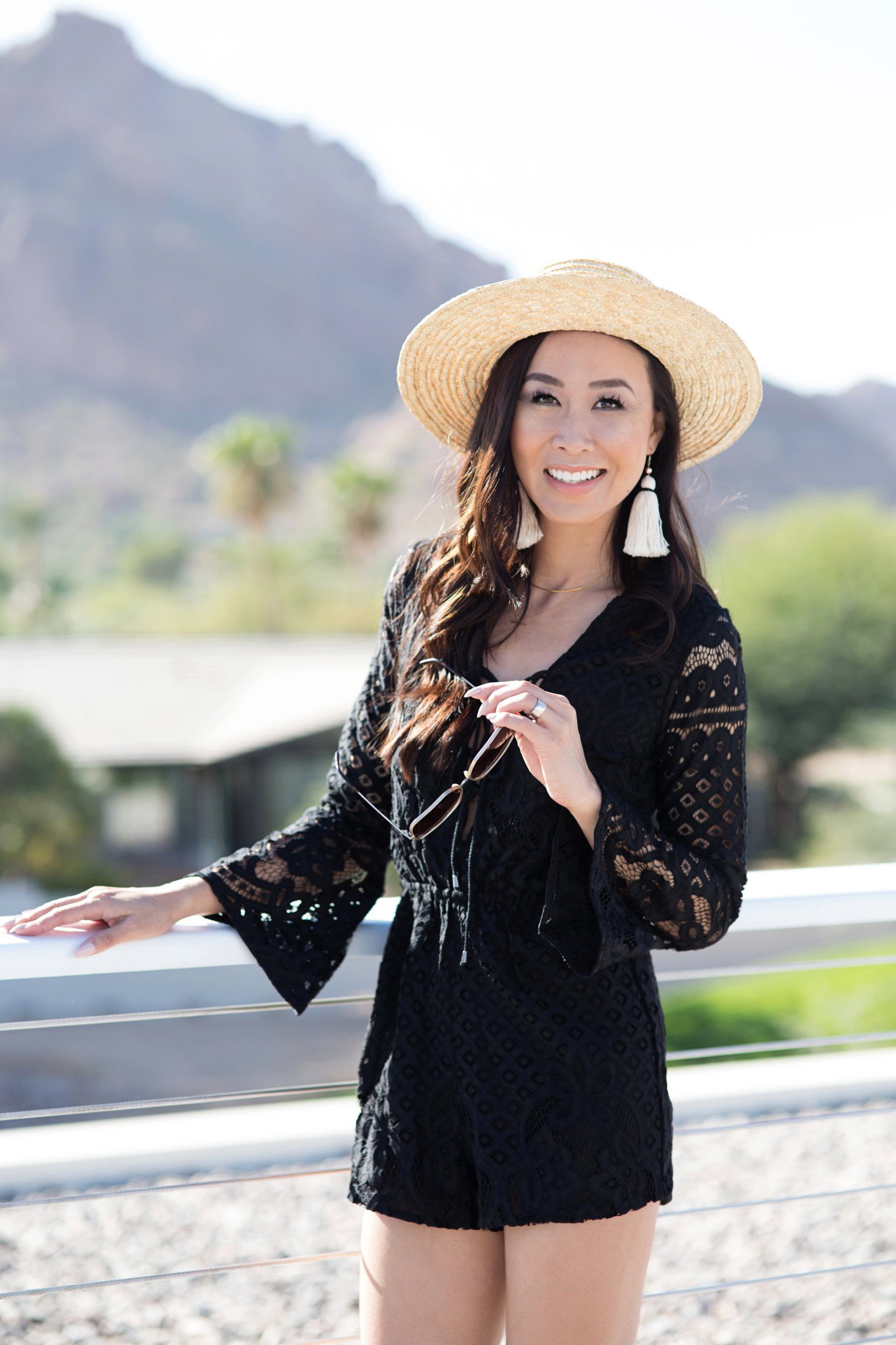 Diana Elizabeth Phoenix blogger in black romper and hat with tassel earrings - talking about if she likes phoenix