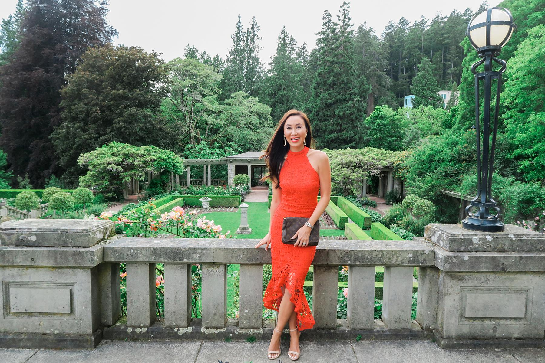hatley castle wedding in Victoria Canada wearing a red lace dress like the emoji