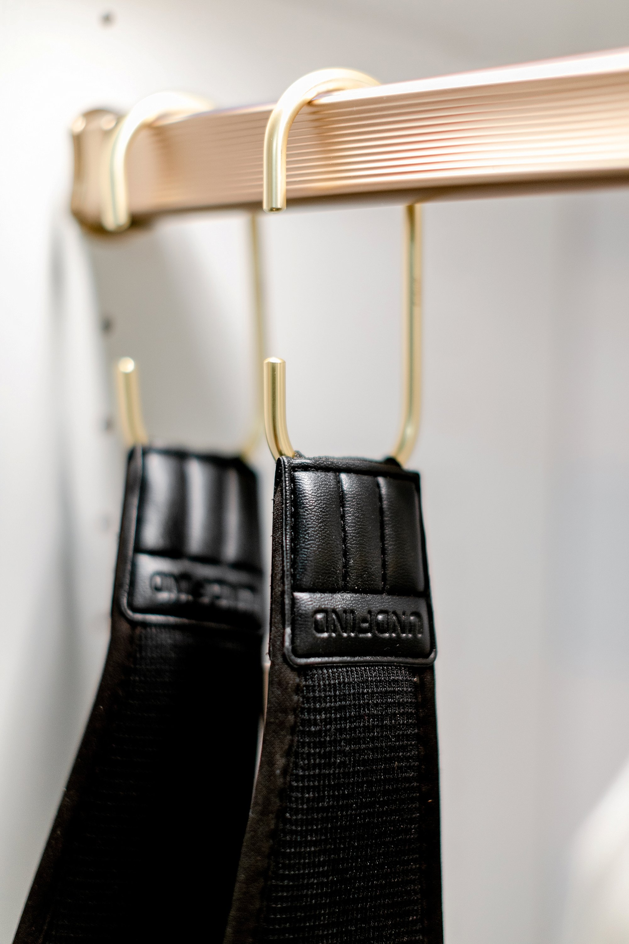 c hooks for handbags in office closet to hang camera bags: final reveal of office closet reveal belonging to photographer blogger Diana Elizabeth in phoenix arizona. created by California closets and with removable buffalo check wallpaper #office #closet #wallpaper #organization #lensorganization #lensdrawer