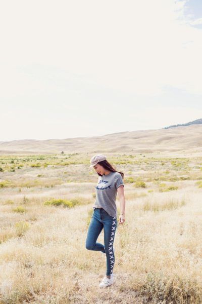 "Wyoming Yellowstone right outside the national park in an ""always wandering"" t-shirt and lace up jeans"