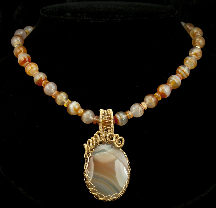 Banded Carnelian Necklace With Agate Pendant Set In Swirls