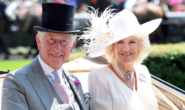 A very windswept Camilla gazes lovingly at the Prince after arrived in the Canadian