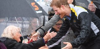 Daphne Dunne, 97, (left) was first in line to meet Prince Harry (right) on Wednesday after waiting in the pouring rain for more than seven hours at Campbell Cove jetty in Sydney