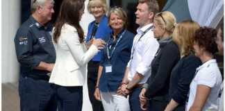 Kate wore a white jacket and cropped blue trousers