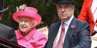 Prince Andrew complemented his mother's colour scheme with his choice of tie and button hole