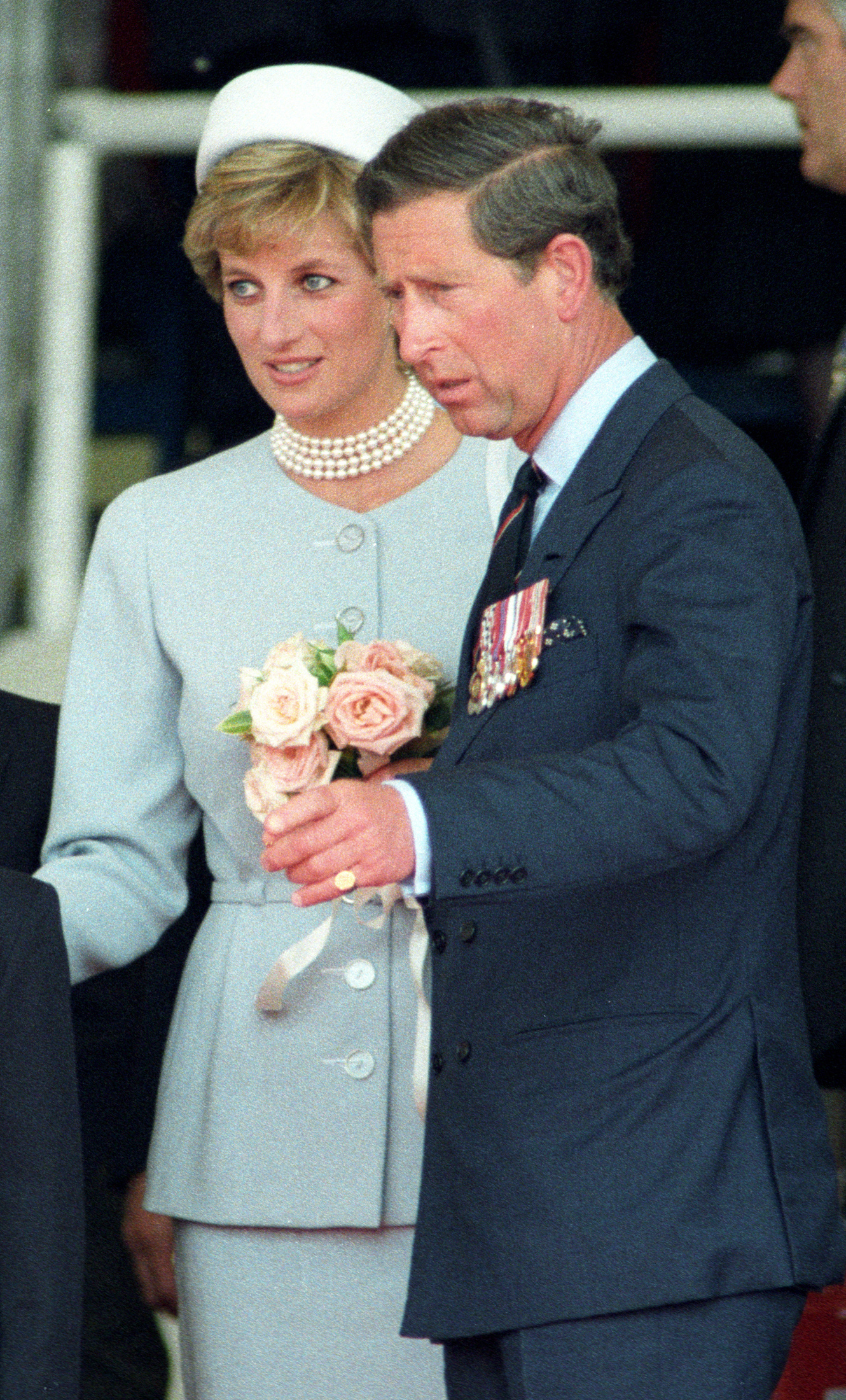 PRINCE CHARLES ESCORTS ESTRANGED PRINCESS DIANA AWAY FROM MAIN PODIUM DURING HEADS OF STATE CEREMONY IN HYDE PARK. Prince Charles escorts his estranged wife Princess Diana away from the main podium during the Heads of State Ceremony marking the 50th Anniversary of VE Day and London's Hyde Park, May 7, 1995. Heads of State from the nearly 60 countries gathered in the sweltering sun for festivities to remember Nazi Germany's defeat in World War II. SCANNED FROM NEGATIVE REUTERS/Dylan Martinez