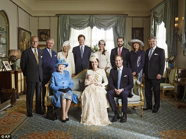 Prince Harry pictured with some of the Royal Family in 2013. Kate, Duchess of Cambridge, holds her son Prince George seated next to Queen Elizabeth II