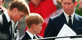 Former husband of Diana, Prince Charles, right, and their two sons Harry (centre) and William wait in front of the Westminster Abbey in London after the funeral ceremony of Princess of Wales Saturday September 6 1997.The body of the Pricess who died in a Paris car crash the previous Sunday was transported to a grave in her family estate following the funeral. (AP Photo/ Joel Robine) BRITAIN_DIANA_CG8.JPG