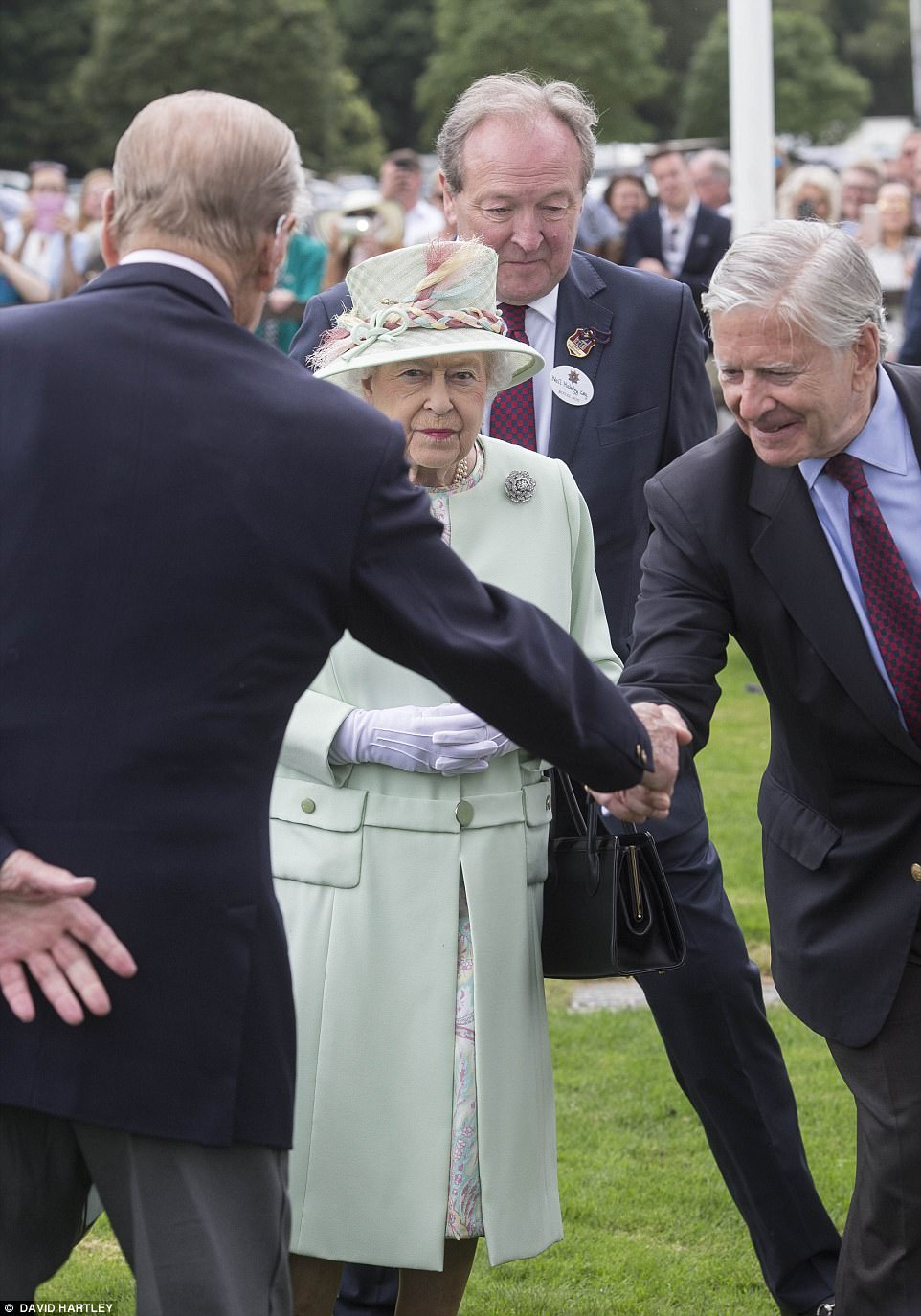 The Duke of Edinburgh could be seen shaking hands with officials on the Smith's Lawn while the Queen looked on