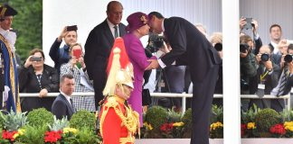Spain's King Felipe VI greets the monarch warmly during Wednesday's official welcome ceremony on Horse Guards Parade