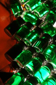 photograph of glass bottles filled with green liquid