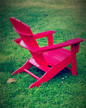 photograph of a red, Adirondack chair