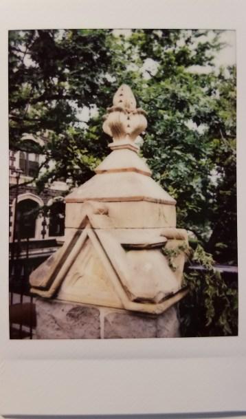 photograph of carved stone cornice on bridge pillar