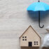 Protection, Model house and umbrella on white background, Finance insurance and Safe investment concepts