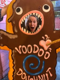 Tracy becoming one with Voodoo Doll donut
