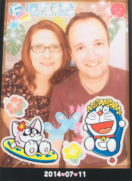 Diane and Kai - photo taken at a photo booth, decorated with Doraemon themed stickers.
