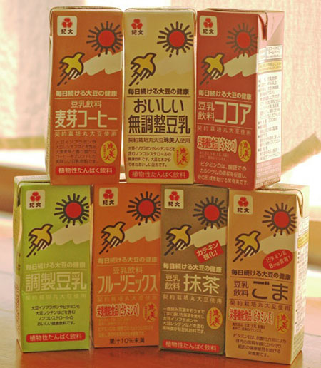 7 small cartons of soy milk in different flavours.