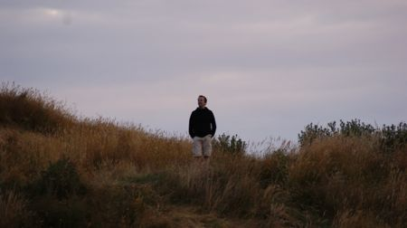 Kai standing on the hill opposite the campsite.