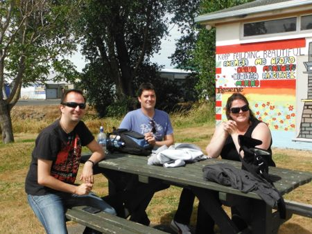 Kai, Nick and Bex sitting at a picnic table.
