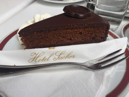 A piece of Sachertorte (cake) with cream.