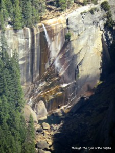 317 FT Vernal Falls blowing in the wind. Those are people in the pool below.