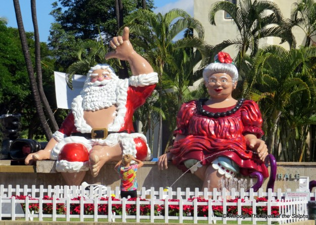 Mrs. and Mr. Santa in front of city hall