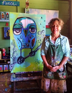 Jenny Odom with her art in Apalach