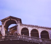 Venetians wave down at us from the Rialto Bridge