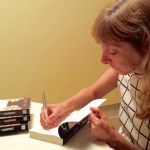 Diane signing copies of Ellen the Harpist